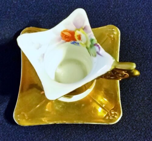 VINTAGE MINITURE  CUP AND SAUCER MADE IN JAPAN GOLD WITH HAND PAINTED FLOWERS