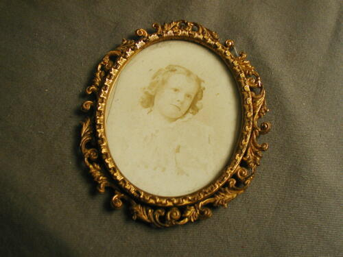 """OVAL PICTURE FRAME - GLASS - FANCY BRASS - PICTURE OF YOUNG GIRL 3 1/2"""" X 4 1/2"""""""