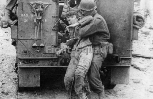 WW2 Picture Photo France 1944 US Soldier picks up a wounded German soldier 3290Photographs - 4727