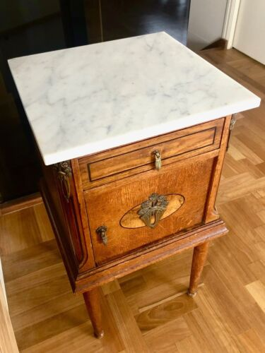 Pair of French oak, ormolu bed side tables with white marble tops, circa 1920