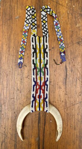 A Superb Old New Guinea Boar Tusk Chest Ornament with Glass Bead Necklace