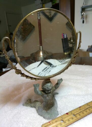 A UNIQUE VINTAGE FACE MIRROR WITH A BRONZE OR BRASS MERMAID AS A STAND!!