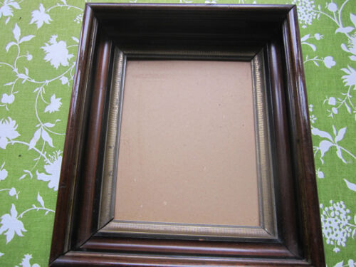 Antique mahogany picture frame,shadow box, and gold accent design.