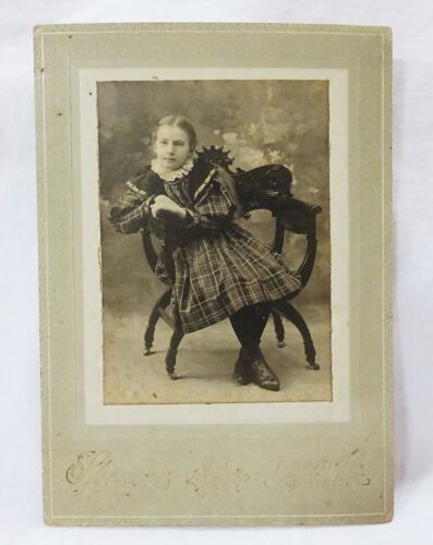 Antique photograph cabinet card girl child in plaid dress sitting on chair 1897