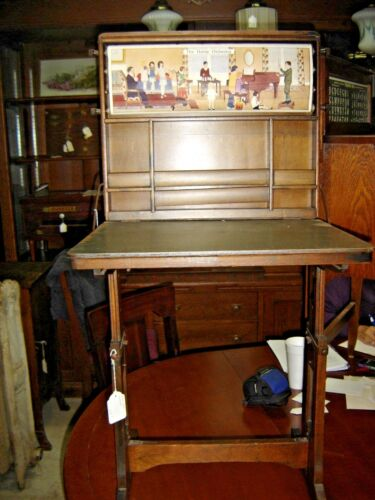 """Antique Child's Oak Desk with """"The Home Orchestra"""". 7910"""