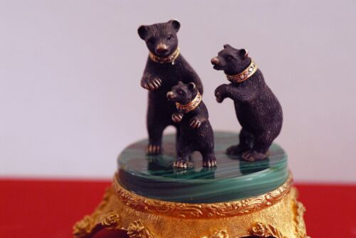 Silver Figurin a family of three bears standing together on a stand.