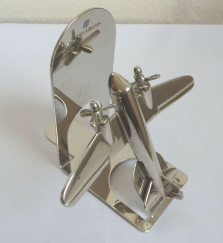 Vintage 2 propeller airplane surface with polished chrome desk model bookend