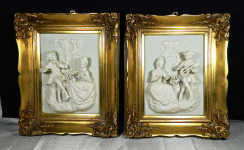 PAIR OF ANTIQUE MEISSEN PORCELAIN PLAQUES OF A COLONIAL COUPLE IN BOLD RELIEF!