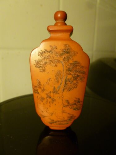 ANTIQUE CHINESE SNUFF BOTTLE  POSSIBLY CINNABAR OR AMBER WITH TREES AND MONK