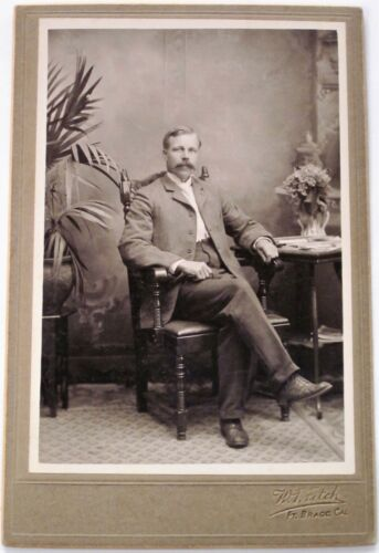 Man w Mustache - antique cabinet photo by Ft. Bragg California photographer