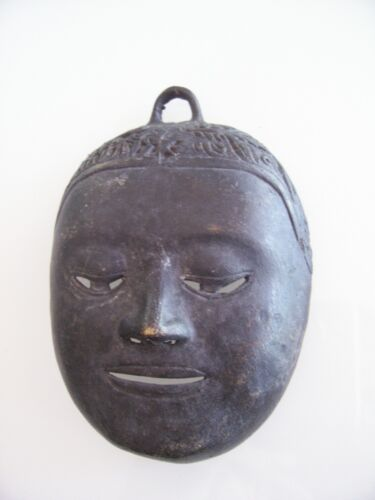 Old  asian bronze mask
