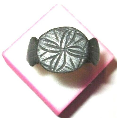Medieval bronze ring with a cross.