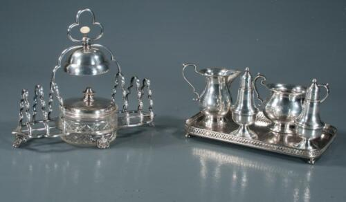 English silver plated toast rack with jam dish and bell along with a st... Lot 6