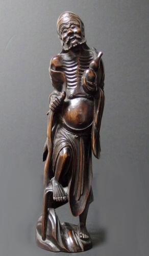 19TH CENTURY CHINESE CARVED WOOD FIGURINE Lot 67