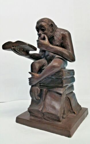 BRONZE FIGURE OF SEATED MONKEY READING A BOOK