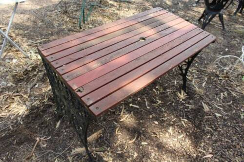 A Vintage Cast Iron and Slatted Timber Out Door Table