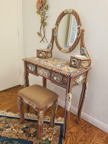 COSMETIC TABLE COVERED BY A BEAUTIFUL SILK  RUG ,