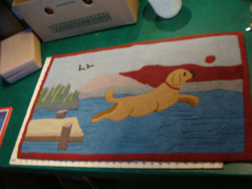"""Rug, 19 x 32"""" DOG JUMPING OFF PIER TO GET BALL, i dont think it is very old ??"""