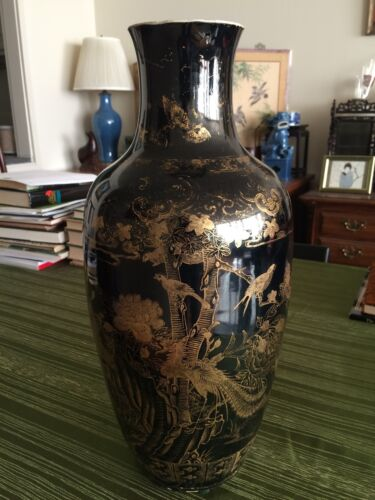 A Beautiful Antique Chinese Porcelain Vase With Black Glaze And Gold Motifs