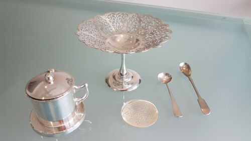 ANTIQUE TEA STRAINER, FOOTED FILLAGREE CAKE DISH AND 2 EARLY SPOONS.