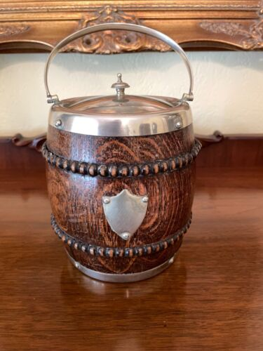 ANTIQUE ENGLISH OAK & SILVER BISCUIT BARREL W BEADED TRIM AND UNMARKED SHIELD