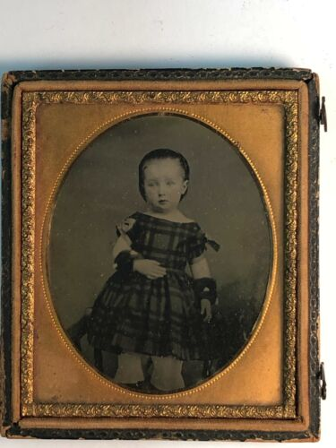 D01_029 Sixth Plate Ambrotype of a Seated Young Child in Half Case