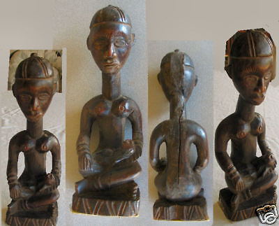 "10 "" carved seated Bakongo maternity figure, expressive face, child on lap"