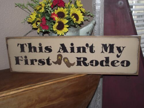 THIS AIN'T MY FIRST RODEO  primitive wood sign