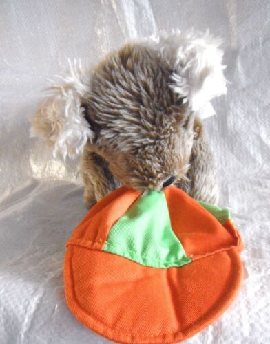 Animal Alley - Puppy dog holding a orange & green cap - plush toy