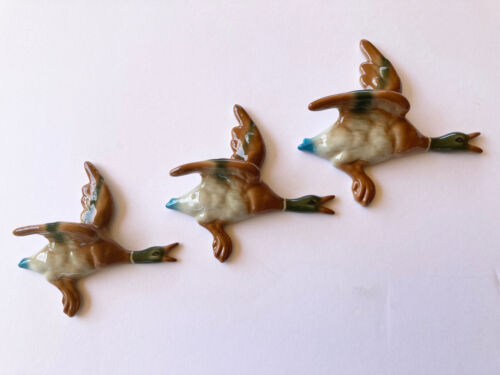 CERAMIC FLYING WALL HANGING DUCKS . DONT COME ANY BETTER .