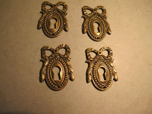 FOUR FRENCH STYLE  SOLID BRASS ESCUTCHEONS