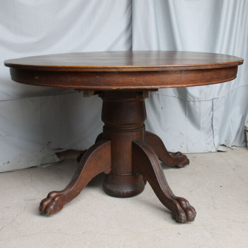 Antique Round Oak Dining Table carved claw feet – original finish