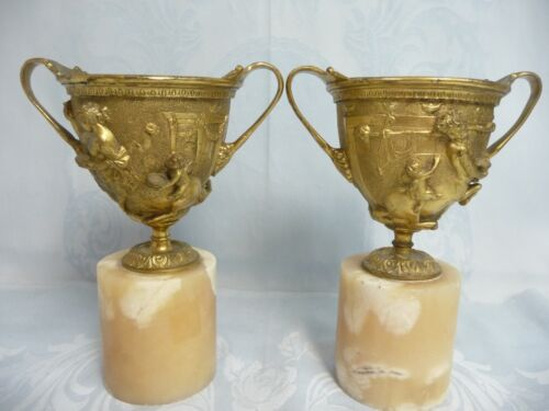 PAIR OF ANTIQUE FRENCH GILT BRONZE URNS w/SATYR & CHERUB, LINERS, MARBLE BASE