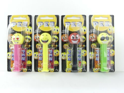 Lot of 4 Emoticon Pez Dispensers. Happy, Lovey, Naughty, Slick. New, Sealed.