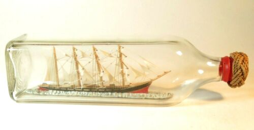 NICE ANTIQUE MODEL WARSHIP IN A BOTTLE WITH CANNON PORTS AND SAILOR KNOT