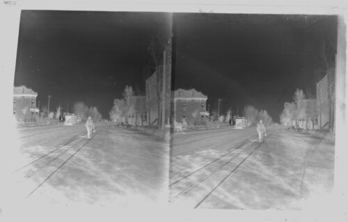 GLASS NEGATIVE for a STEREOVIEW, STREET SCENE WITH TROLLEY MAN WALKING, UNKNOWN