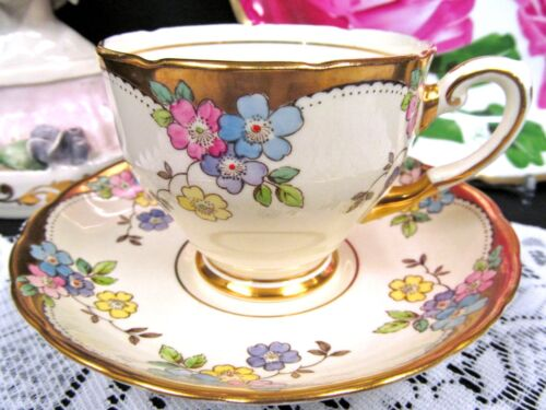 TUSCAN TEA CUP AND SAUCER BANDS OF GOLD PAINTED FLOWERS PATTERN TEACUP