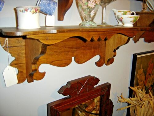 Antique Chestnut Clock Shelf with sawtooth design on the front. 8166