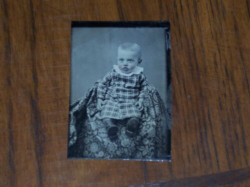 Tintype of a sweet little baby. Colored cheeks Good posture Nice shape. Look