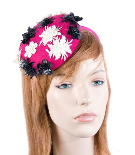 Fuchsia pillbox fascinator with small flowers by Max Alexander. RRP: $89.95