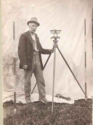 Cabinet Photograph of a Surveyor Posed with His Equipment c1900