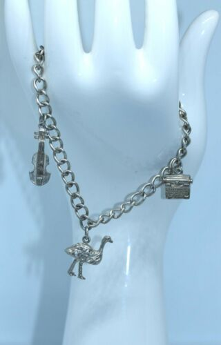 SWEET VINTAGE STERLING SILVER CHARM BRACELET WITH THREE CHARMS 14.1 GRAMS NICE