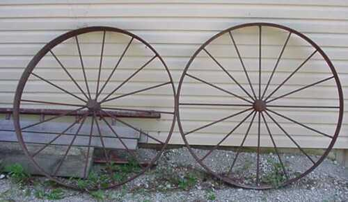 TWO VINTAGE 4' FOUR FOOT TALL STEEL WAGON WHEELS