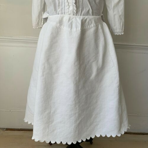 Petticoat or skirt  white cotton  textured with scalloped edge c 1900