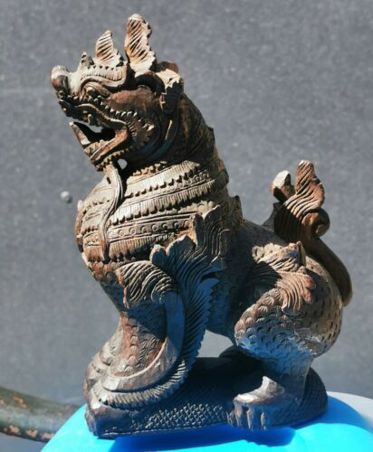 Antique beautifully and powerfull hand carved dragon dog in wood from China